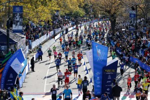 Runners celebrate the Finish of the 2014 TCS New York City Marathon. (Credit: Courtesy NYRR)