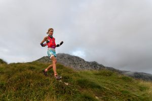 Woman with Salomon Vest Trail running ultrarunner in the mountains alpine