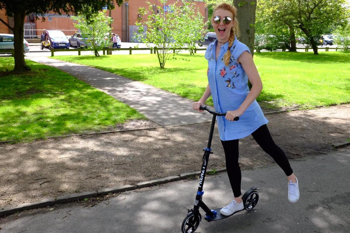 adult on Frenzy scooter