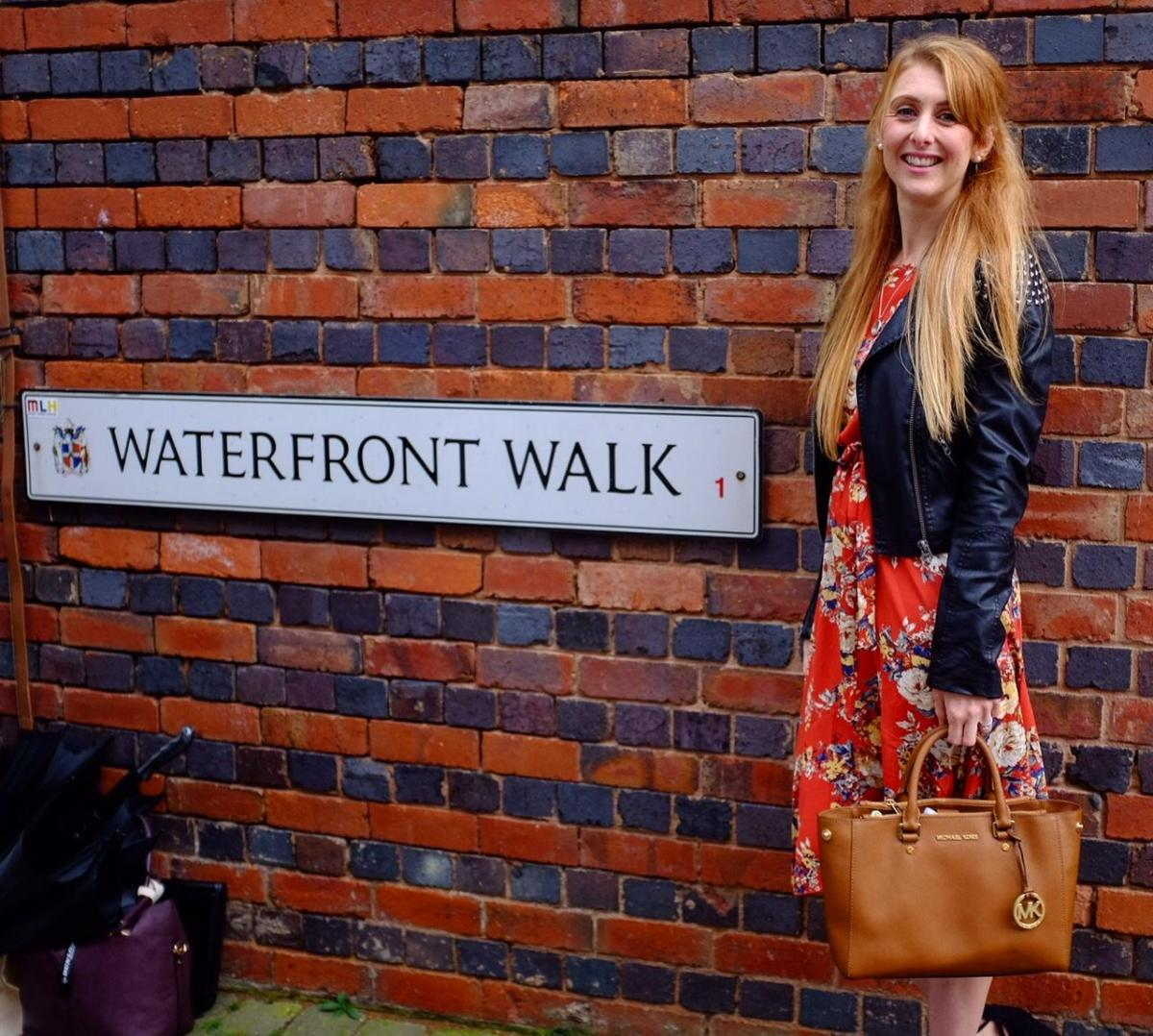 waterfront walk sign. and girl