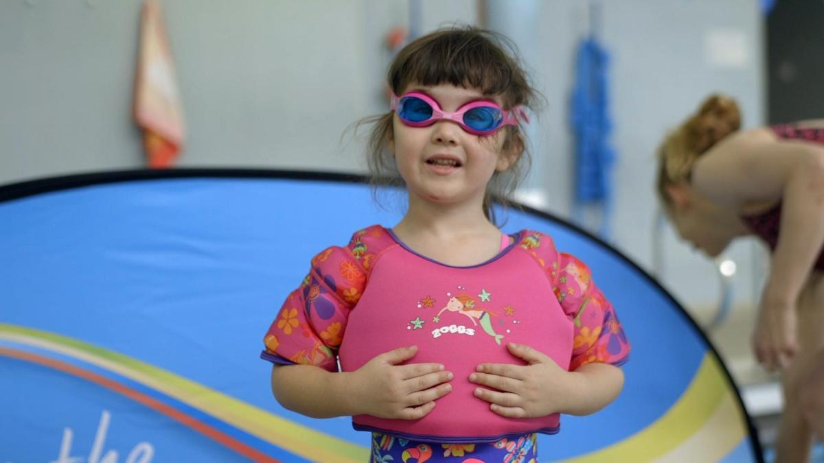 girl wearing the zoggs swim vest