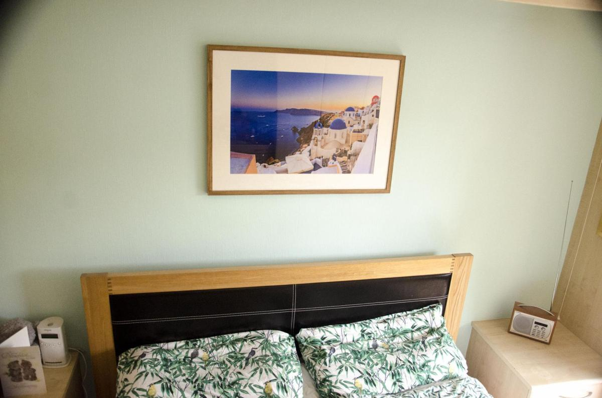 Santorini picture on the wall of a bedroom