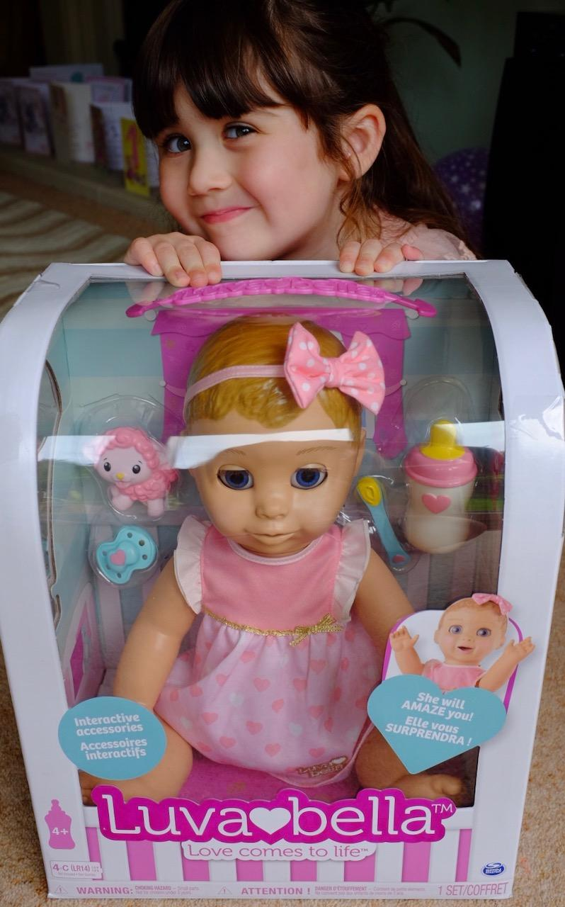 girl with luvabella doll box