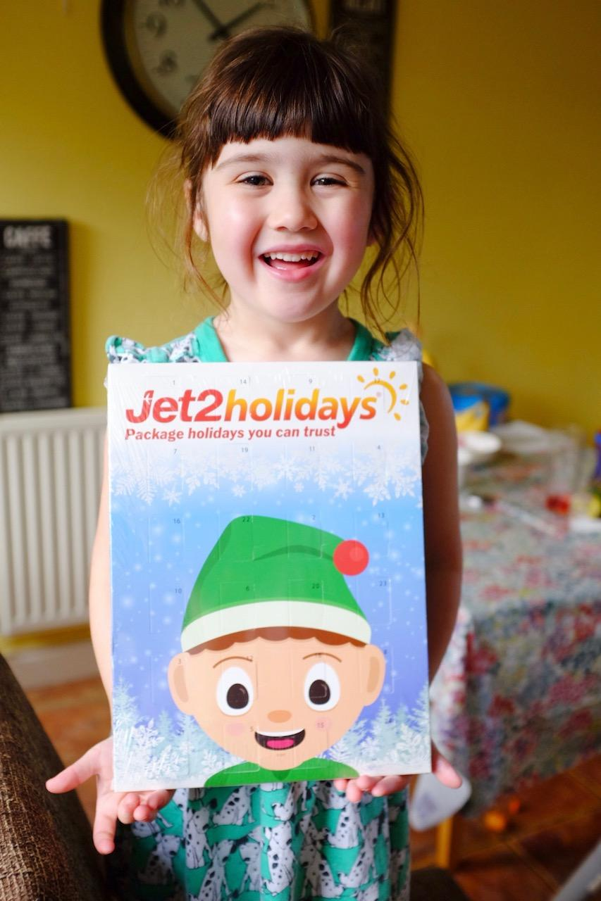 girl holding a jet2 holidays advent calendar