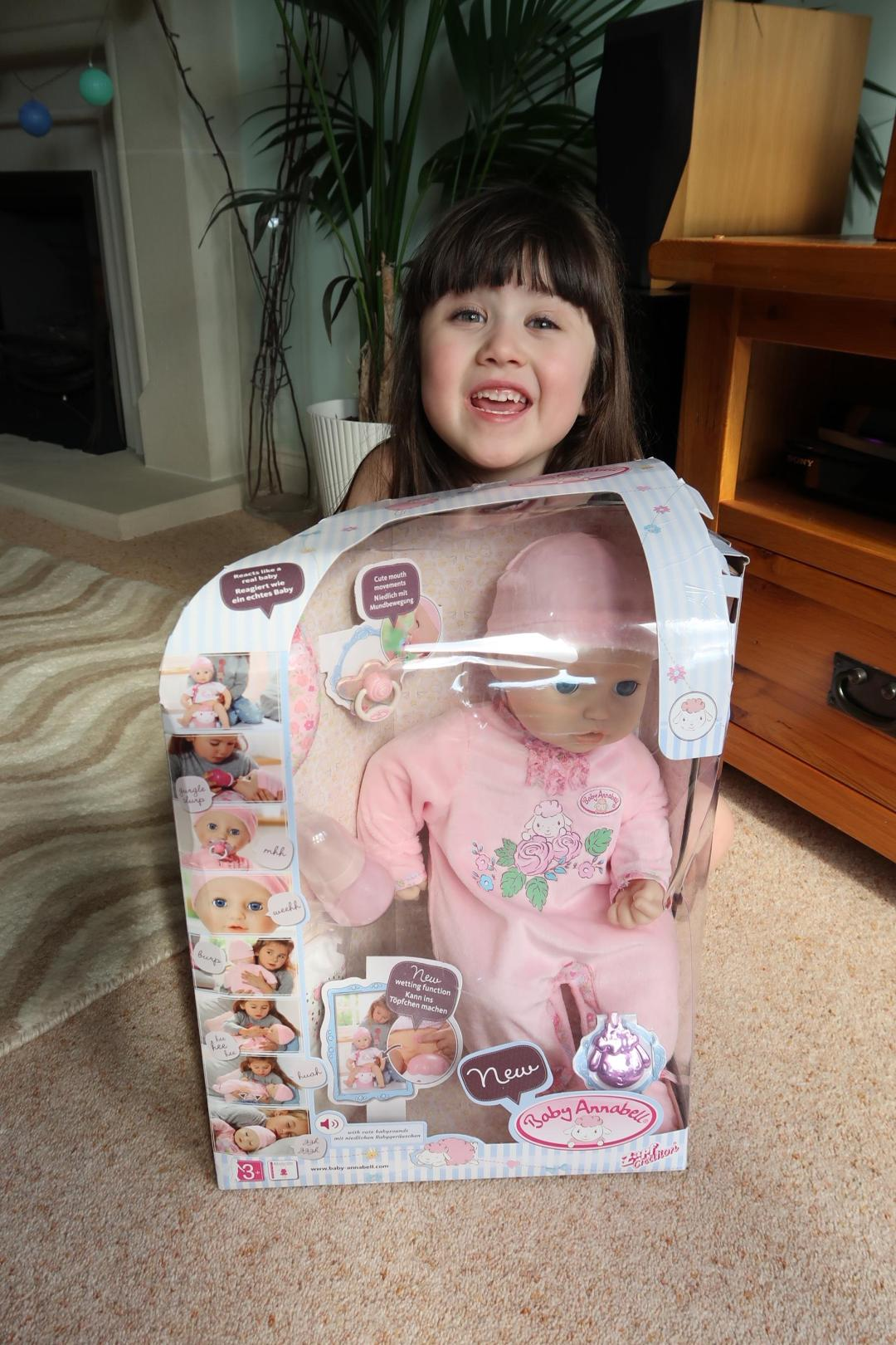 girl excited over interactive baby Annabell doll