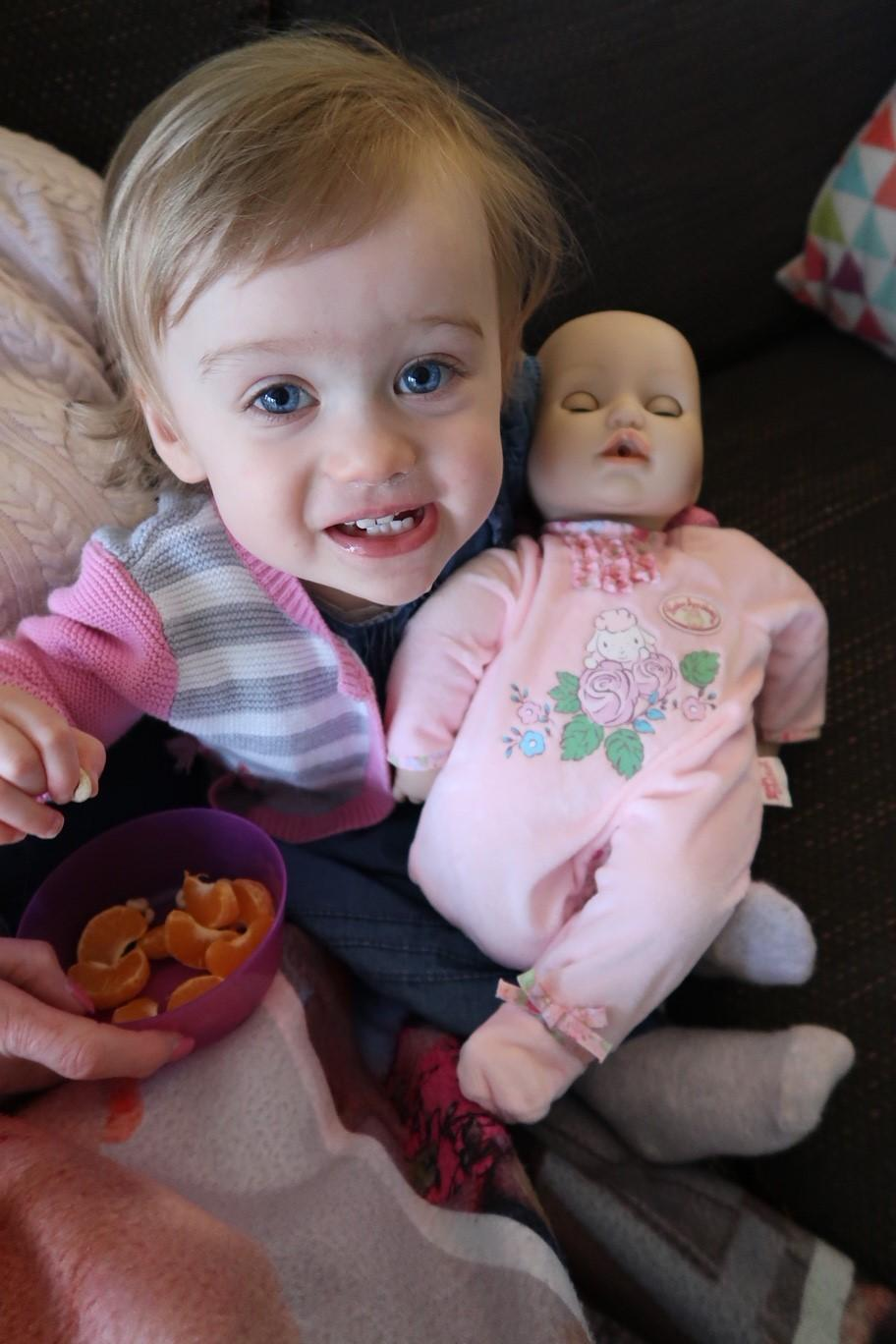 Baby girl playing with the Baby Annabell Interactive Doll