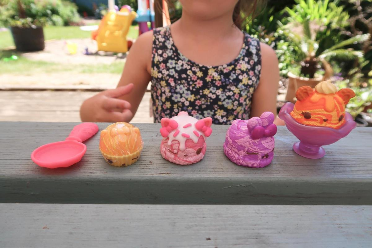 girl playing Num Noms Series 5 marble ice cream starter pack