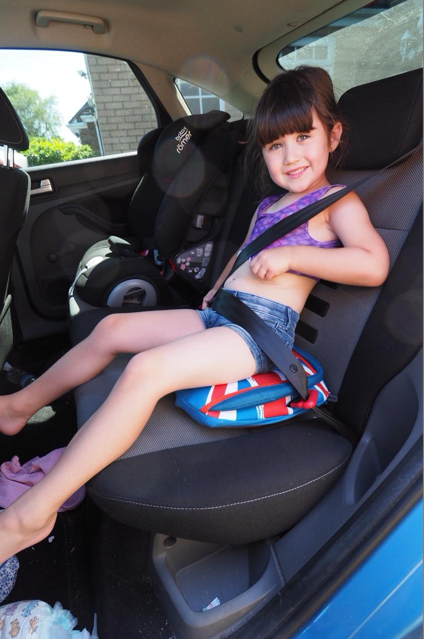 child sitting on bubblebum booster seat