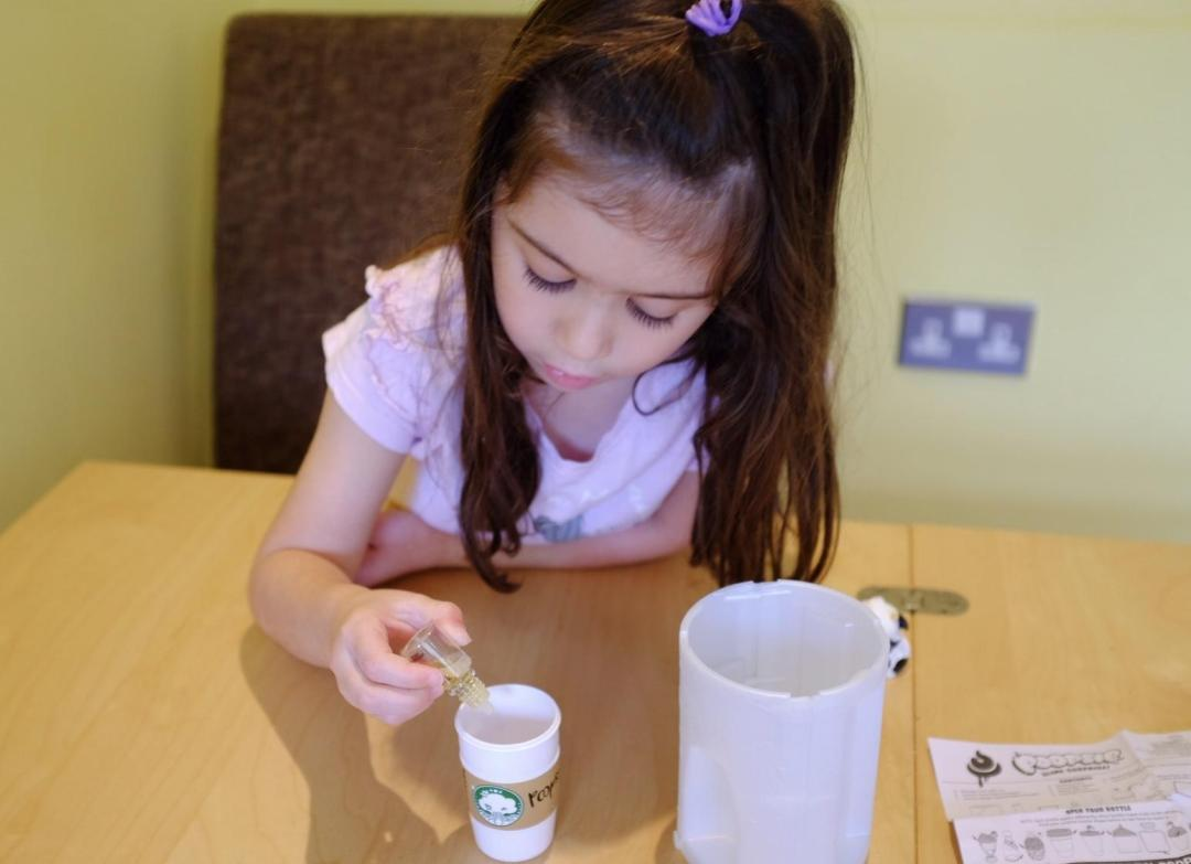 girl adding scent to slime from Poopsie Slime Surprise