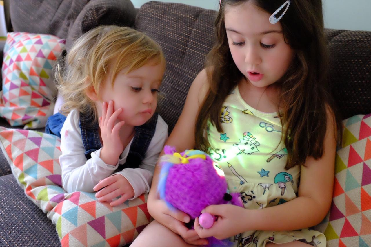 sister looking at the Hatchimals HatchiBabies