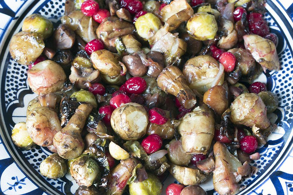 ROAST BRUSSELS SPROUTS AND JERUSALEM ARTICHOKES WITH CRANBERRIES AND CHESTNUTS