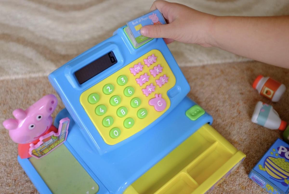 using the chip and pin card on the Peppa Pig Cash Register