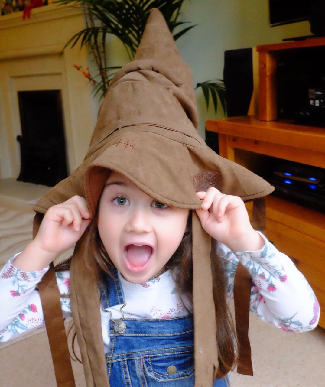 girl wearing the sorting hat