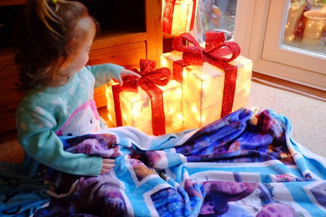 girl sat under truprint fleece blanket