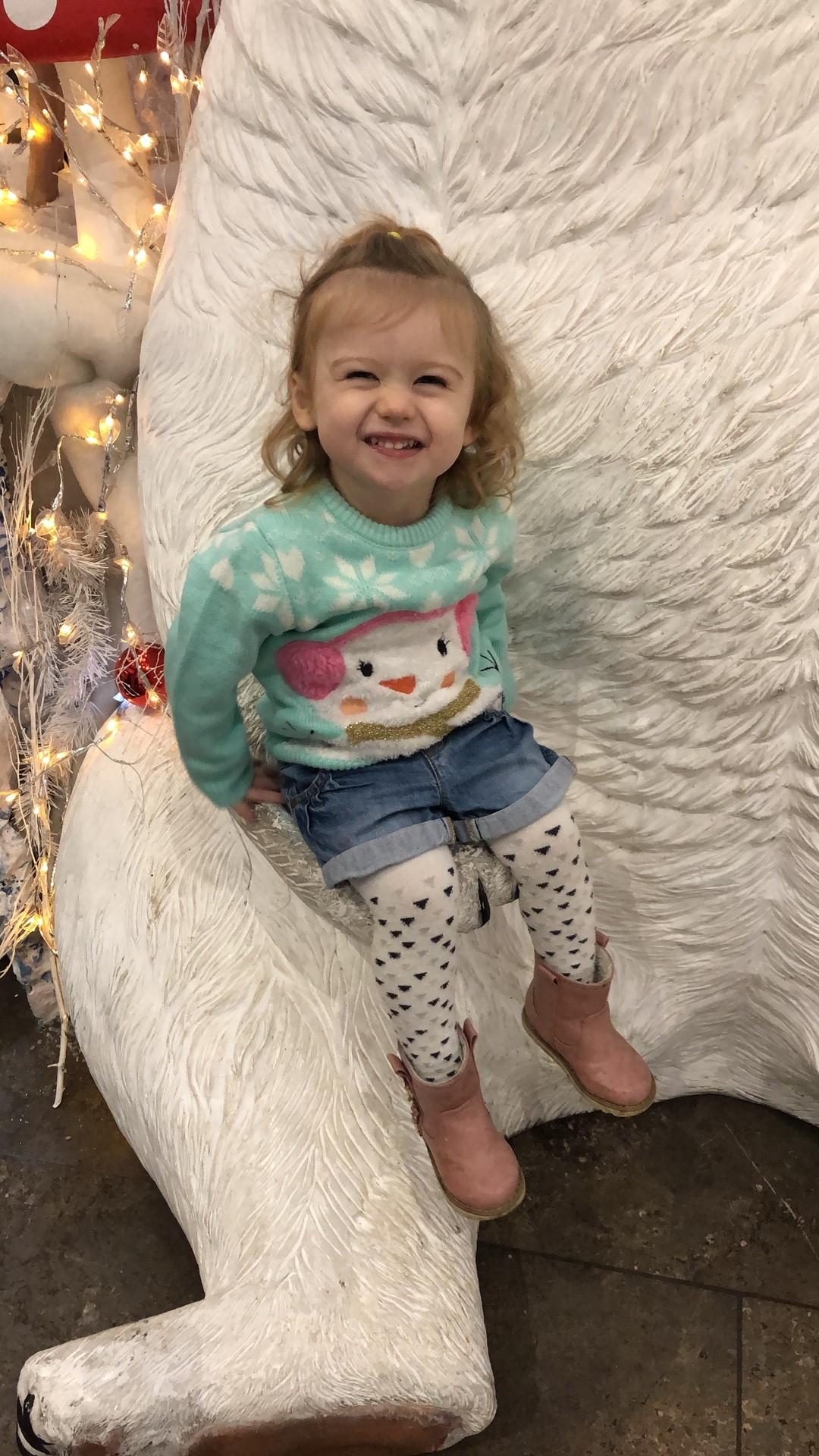 grinning little blonde girl