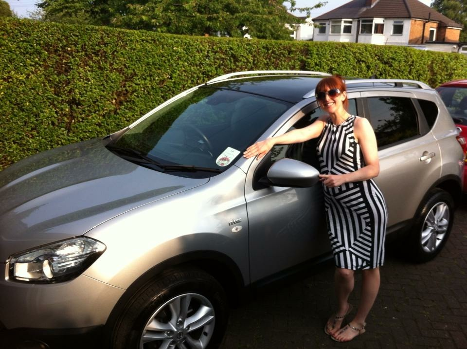 Girl with a new grey Nissan Qashqai