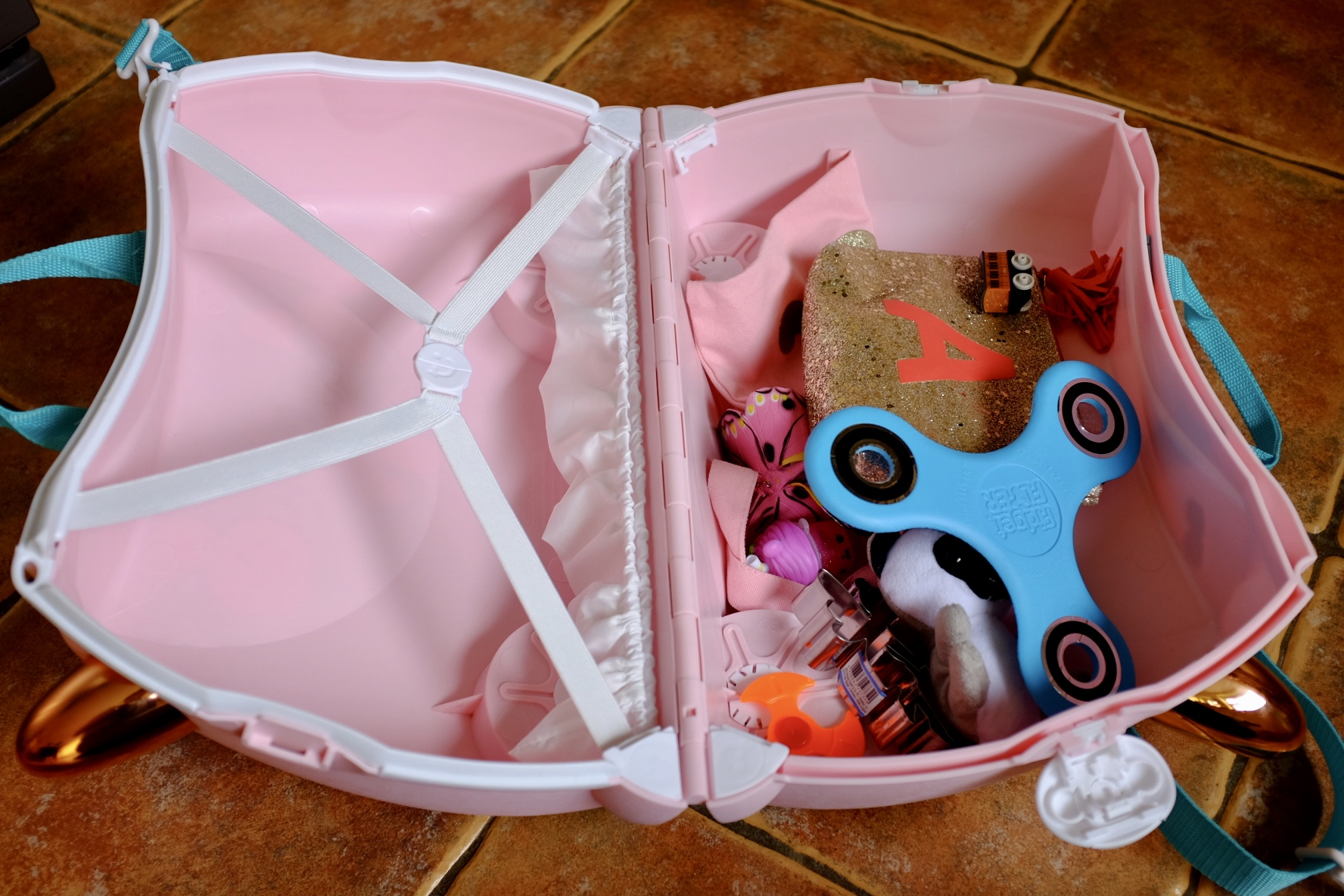 Flossi the Flamingo Trunki with toys in