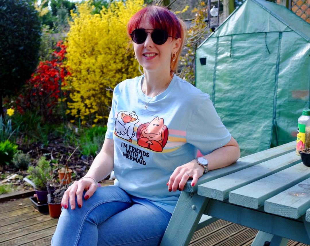 redhead wearing a little mermaid tee from shopDisney