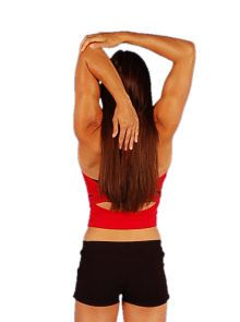 A woman doing an overhead tricep stretch.