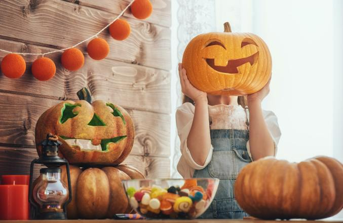 girl with carving pumpkin