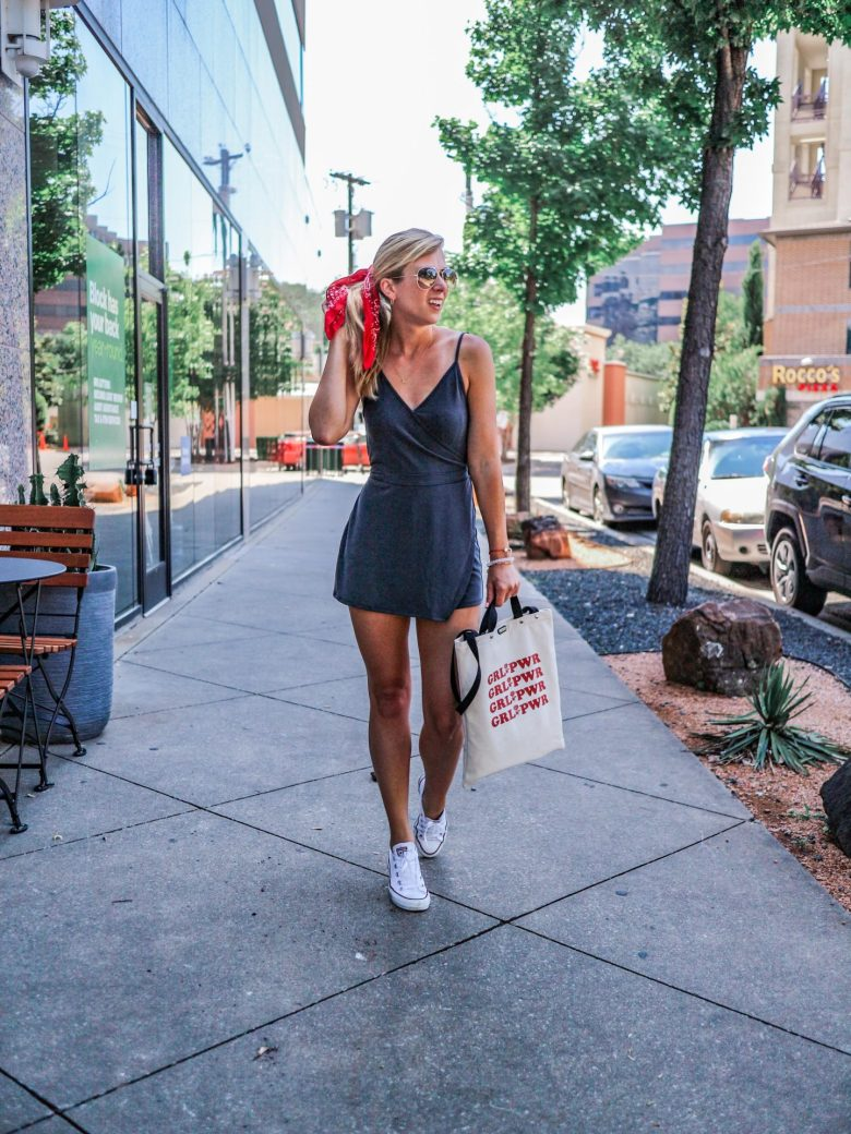 Cute 4th of July outfits featured by top US fashion blog, Running in Heels: image of a woman wearing an Abercrombie & Fitch skort romper, Converse low top sneakers, DIFF Aviator sunglasses, Target red bandana scarf, and BAUBLEBAR bracelet set.