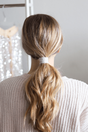 5 Festive Holiday Hairstyles for the Season featured by top Dallas beauty blogger, Running in Heels: wrapped ponytail