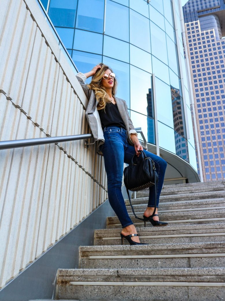 Top US Fashion and Lifestyle Blogger Running in Heels features HM plaid blazer, black lace cami, jeans, black mules in post What to do if you're unemployed | Running in Heels | Business casual look