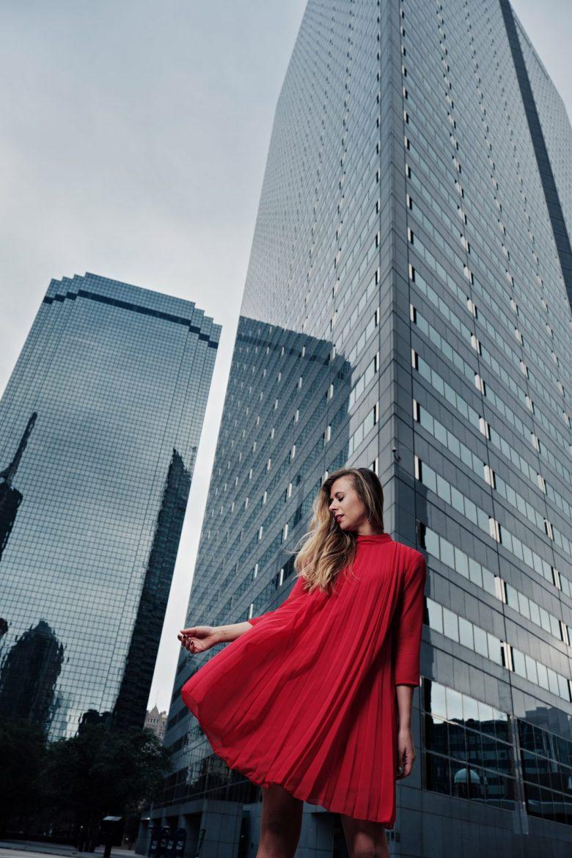 Kasey Goedeker of Running in Heels wears a red trapeze dress downtown dallas. Photo by Jeff Dietz
