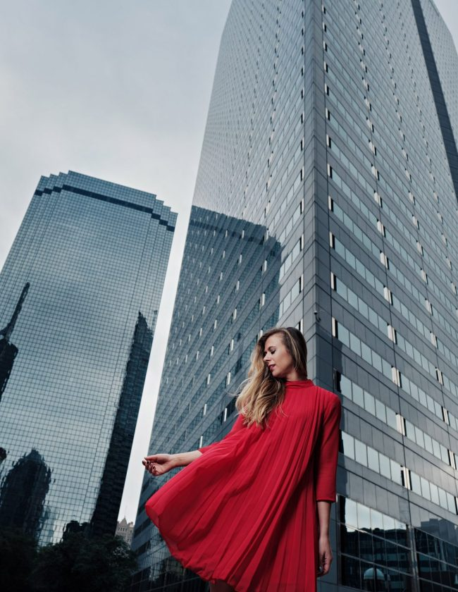 Kasey Goedeker of Running in Heels wears a red trapeze dress downtown dallas. Photo by Jeff Dietz