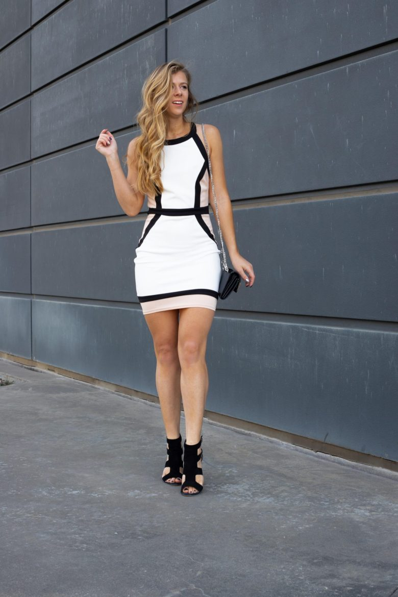 Kasey Goedeker of Running in heels wears a neutral color block dress paired with black block sandals