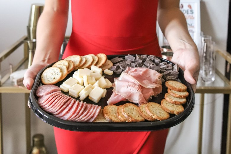 Hosting Tips for the Best Friends Holiday Party, try a Hillshire Farm snacking platter instead of building your own charcuterie board. Feature by top US fashion and lifestyle blogger Running in Heels