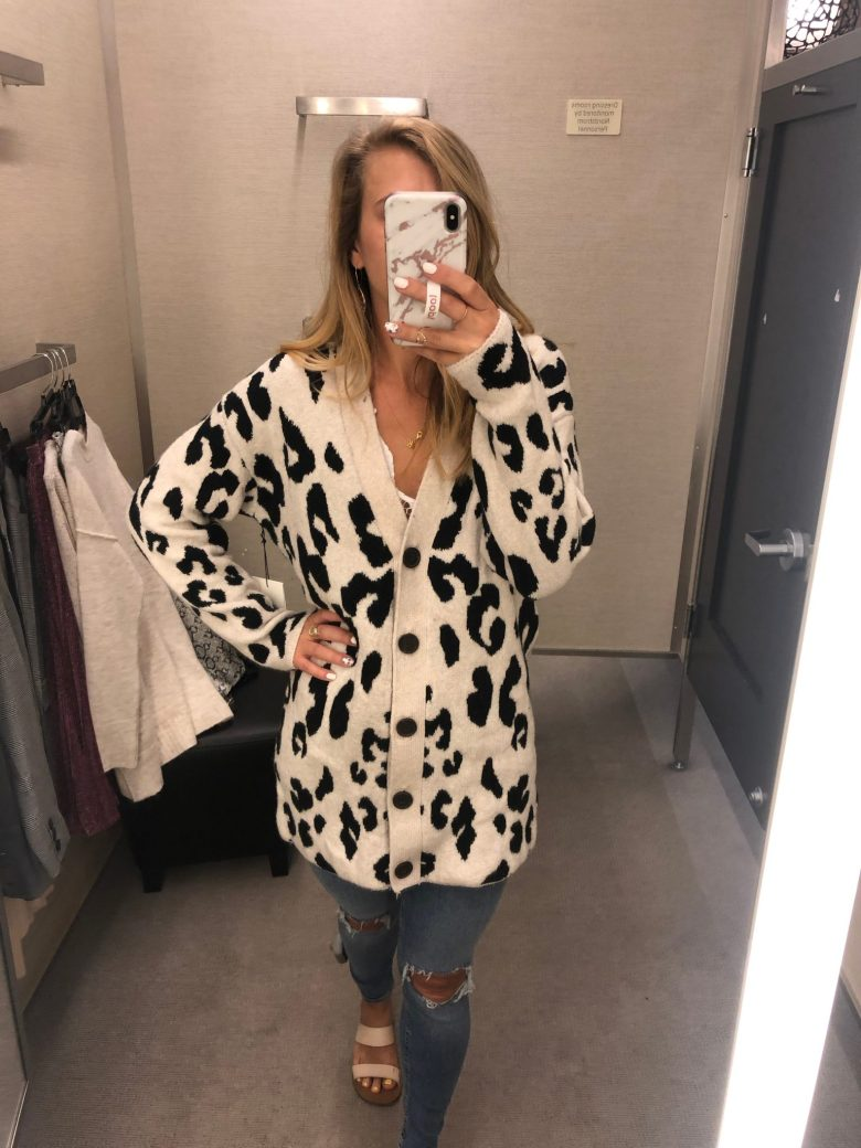 Nordstrom Anniversary Sale trends featured by top US fashion blog, Running in Heels: unstructured jackets: animal prints - image of a woman wearing a snow leopard print cozy cardigan