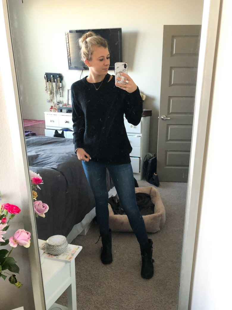 Top US fashion and lifestyle blogger, Running in Heels wears Revolve Superdown sweater with J Brand jeans, and moto boots.