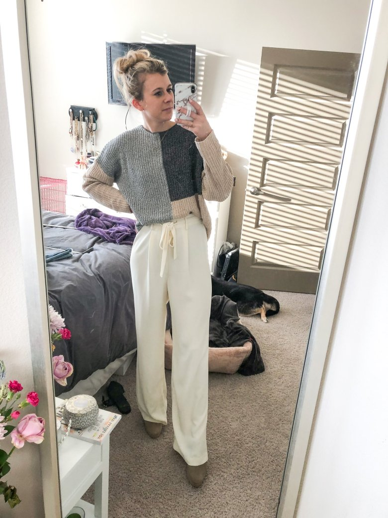 Top US fashion and lifestyle blogger, Running in Heels wears color blocked Shein sweater with white wide leg pants from Target and Journee mules.