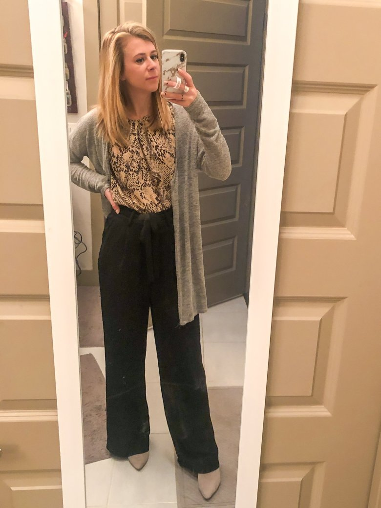 Top US fashion and lifestyle blogger, Running in Heels wears snakeskin top with Target Style workwear pants, and Journee mules.