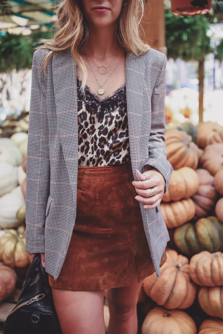 How to Wear the Animal Print Trend this Fall, styling tips featured by top US fashion blog, Running in Heels: image of a woman wearing a leopard cami.