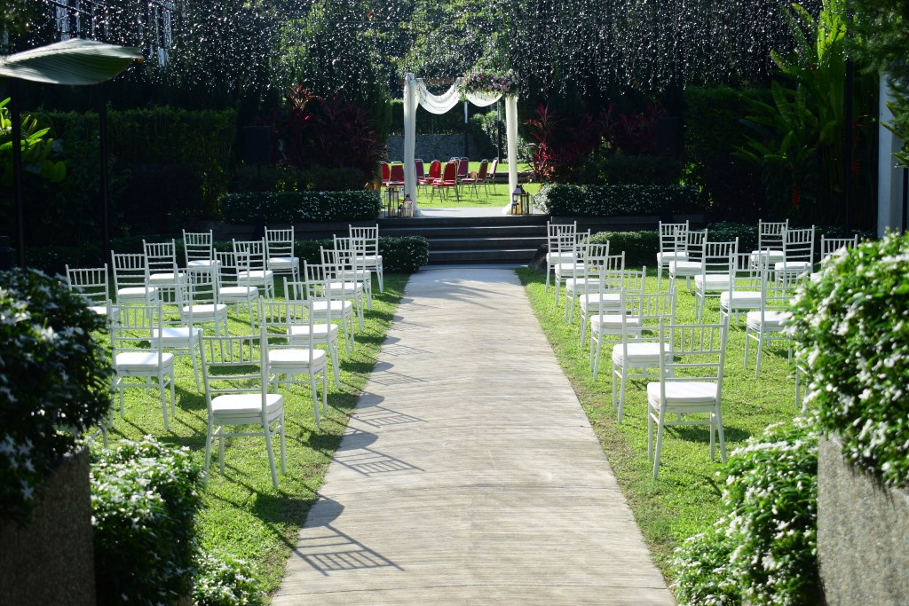 runningmen catering wedding services with table setting on an jungle themed event space