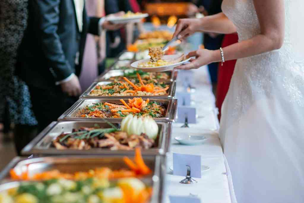 runningmen catering buffet line with people taking food