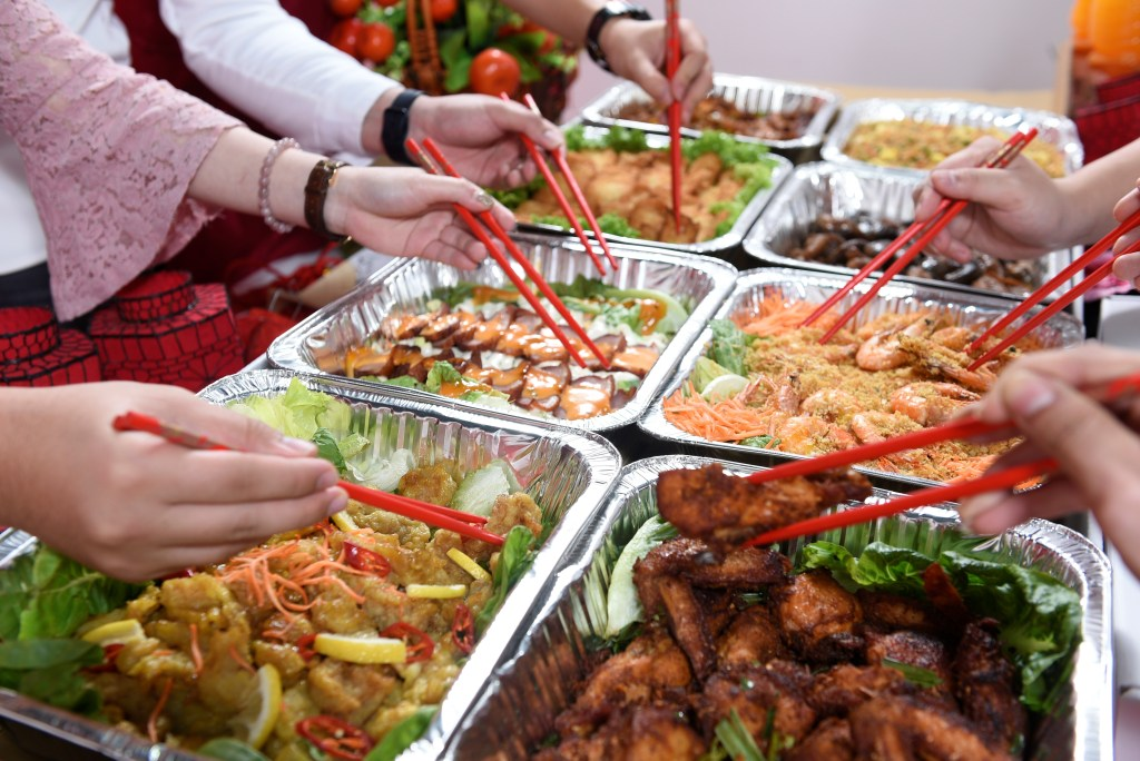 runningmen catering chinese new year traditional chinese catering for cny 2021 photo with people taking food