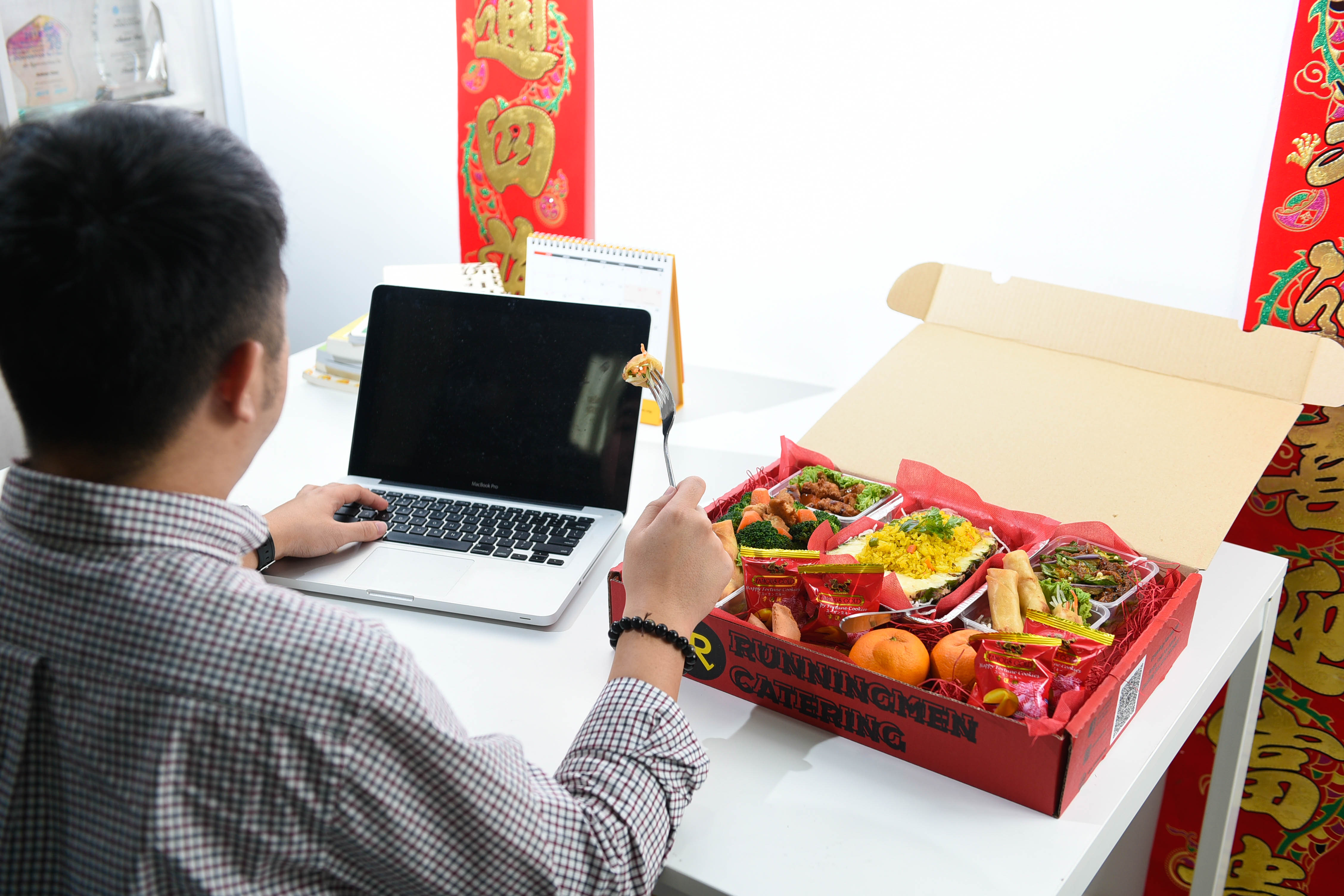 runningmen catering foodie box for corporate with man having virtual party 3