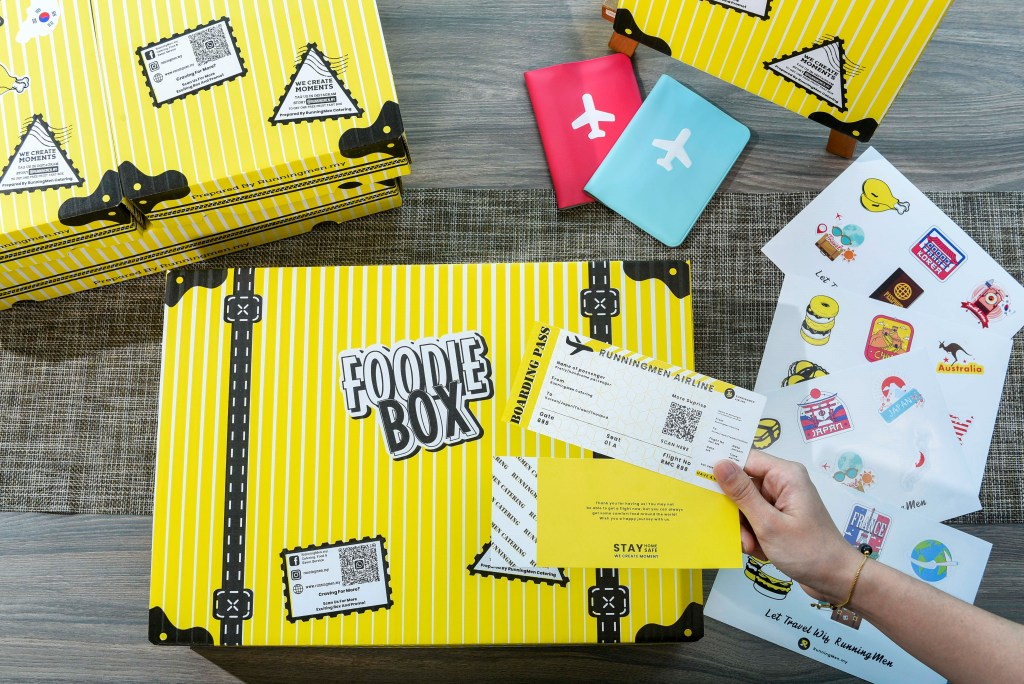 runningmen catering travel theme packaging with luggage box and boarding pass