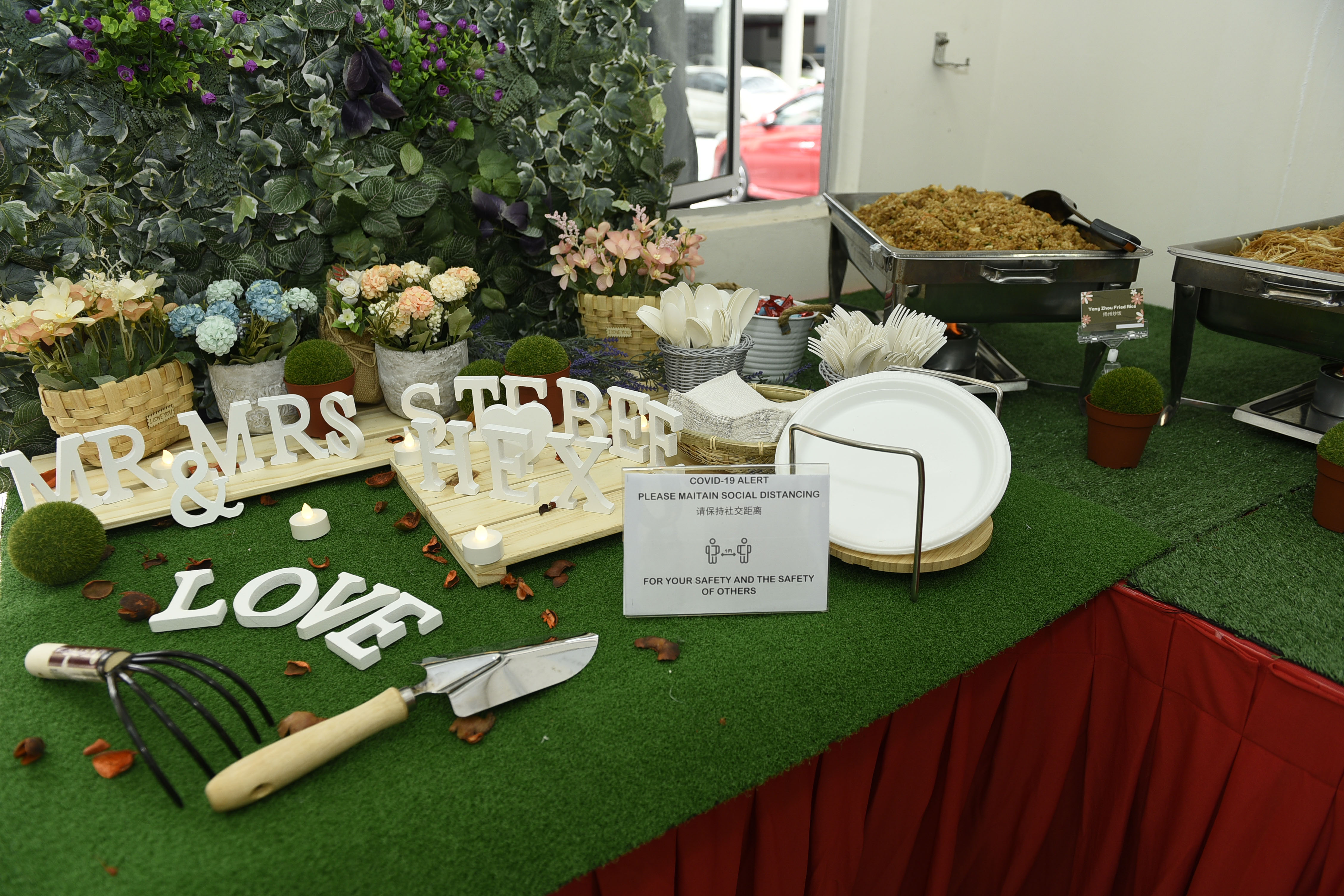 runningmen catering buffet line with beautiful decorations