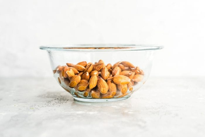 Drained and Rinsed Almonds in a Glass Bowl for Making Almond Milk