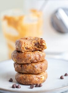 A stack of 4 no-bake cookies on a white plate.