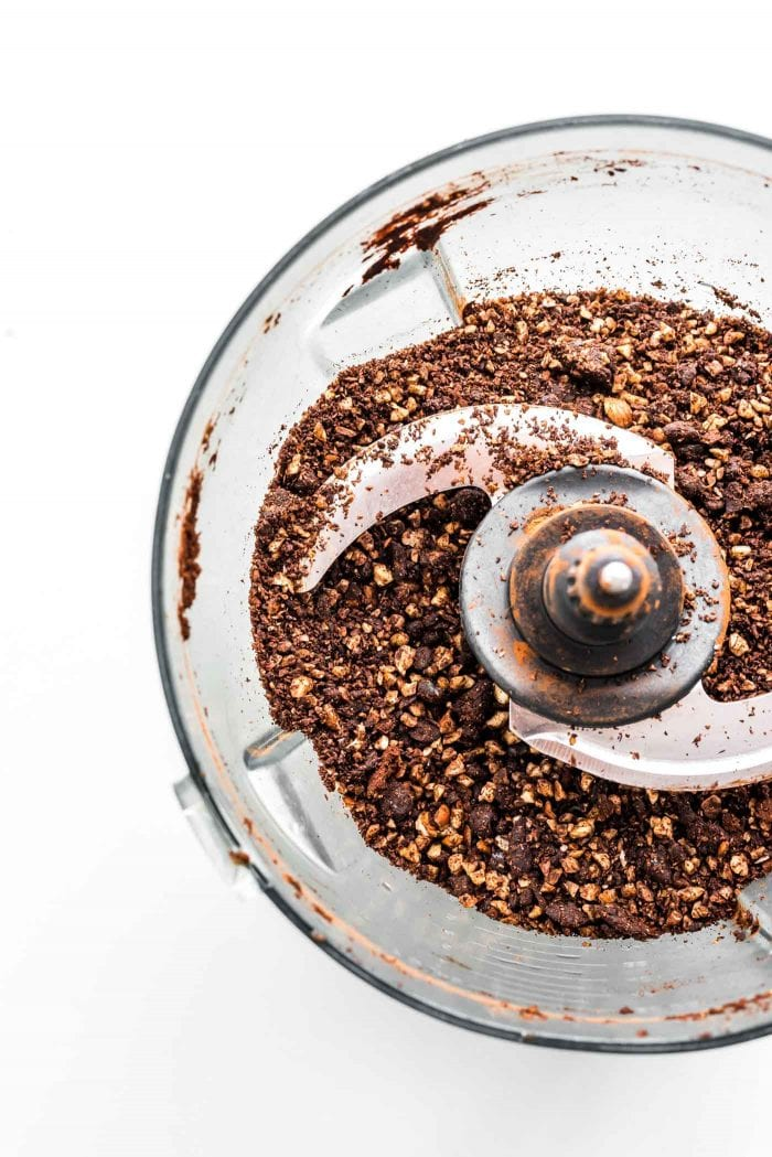 Blended hazelnuts, cocoa powder and dates in a food processor.