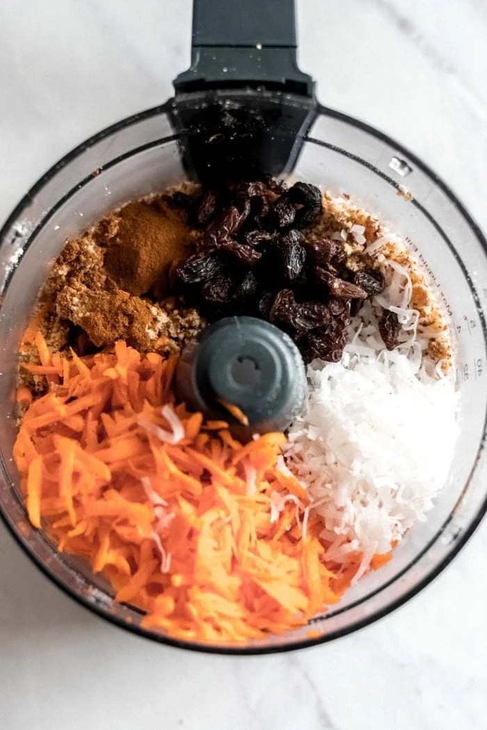 Ingredients for raw vegan carrot cake in a food processor.