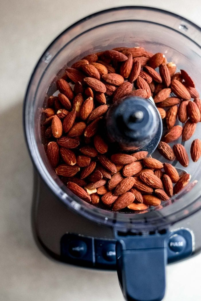 Almonds in a food processor container.