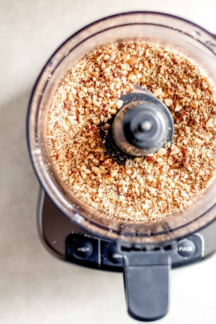 Almonds blended into a grainy flour in a food processor.