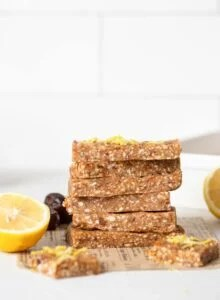 A stack of lemon energy bars on a kitchen counter.