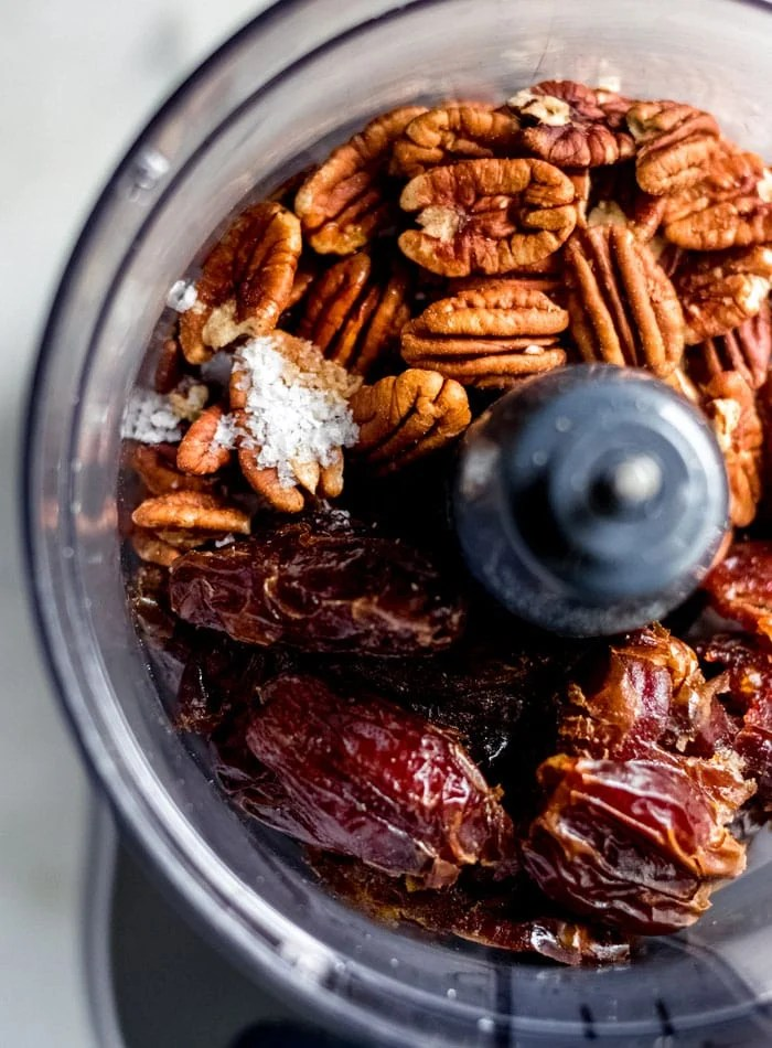Dates, pecans and sea salt in a food processor.